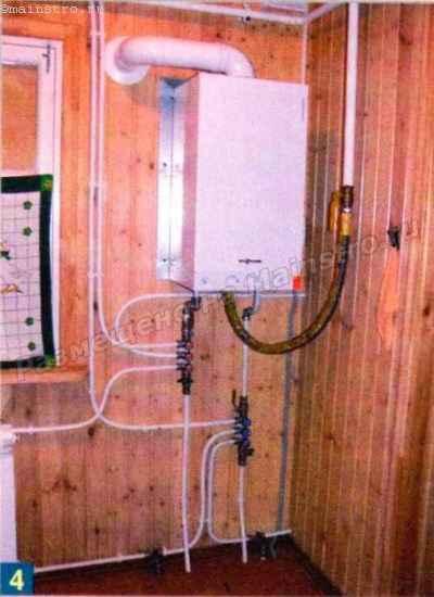 Центральный фрагмент системы отопления: обвязка котла, линии подачи воды на 2-й этаж дома и слива её из системы