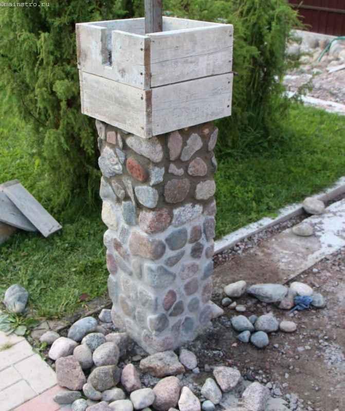 Заборы с каменными столбами