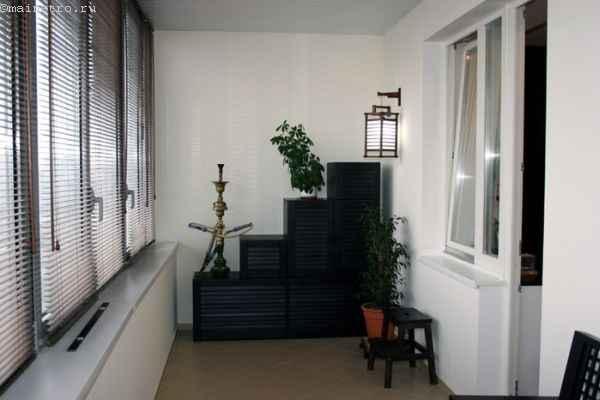 Утепленная балкон-комната - фото