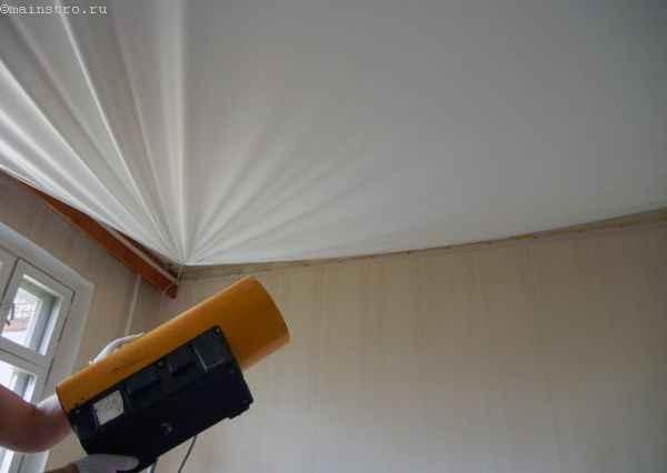 Нагреваем натяжной потолок  с помощью тепловой пушки