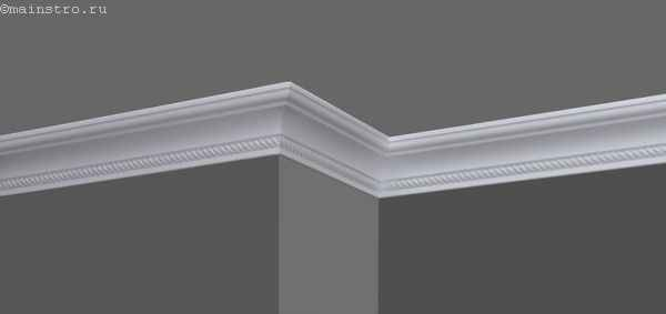 Приклеенный к стене плинтус для натяжного потолка (галтель)