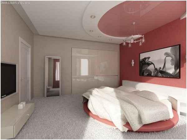 Двухуровневый натяжной потолок овальной формы в спальне