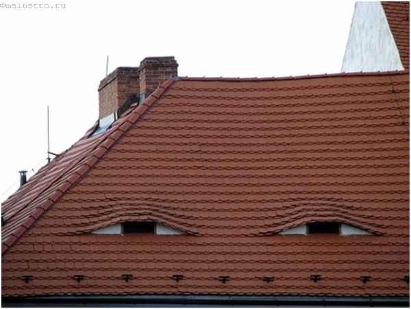 Фото готовой крыши с мансардными окнами