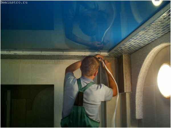 Завершение установки натяжного потолка