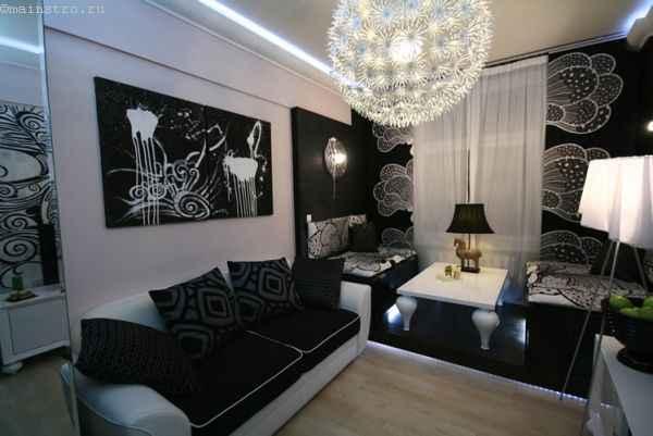 На фото чёрно-белые натяжные потолки с подсветкой по периметру