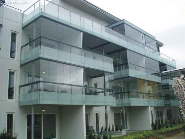 Фото безрамного остекления балкона или лоджии